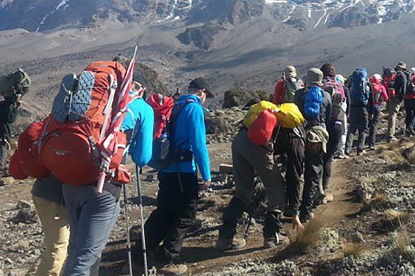 Trekking up mount kilimanjaro